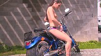 Hot motorcycle babe strips for the camera - X69video thumbnail