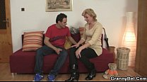 Blonde granny jumps on young cock Preview