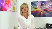 English gilf Dolly puts her dildo to work on he...