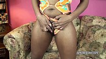 Ebony MILF Kelly Stylz is playing with her sweet pussy preview image