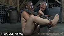 Gagged cutie is punished with painful toy playing