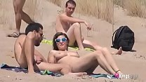Sol fucks a guy in a beach surrounded by voyeurs video