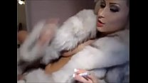 Trisha Annabelle smoking on webcam fur coat