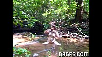 Fatty lesbian strumpet plays in water outdoor in the woods