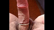 Jerking off with a rubber band cock ring
