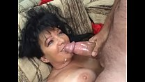 Darkhaired cougar with big boobs in red transpa...
