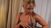 Sexy blonde babe rides dildo on the table.