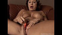 Gorgeous granny with nice big tits fucks her juicy pussy for you صورة