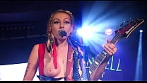 Here's A Random Female Rocker With One Of Her Titties Out