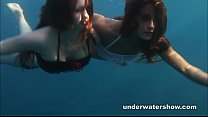 Nastya and Masha are swimming nude in the sea