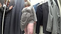 A plump milf with a juicy ass in white panties and big tits in a bra got into the lens of a hidden camera in a public dressing room. صورة