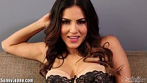SunnyLeone Striptease on the couch Thumbnail