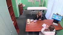 Sexy blonde patient in lingerie at doctors preview image