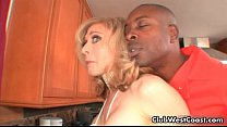 Horny blond houswife Nina Hartley gets thumb
