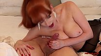 Slutty MILF Red sucks dick and jerks him off thumbnail