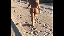 Naked Chick Walking On The Beach