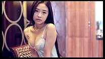 Chinese Model Poses for Money