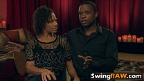 White and black couples having swinging fun preview image