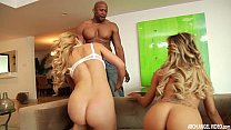 Two hot blondes share a big black cock preview image