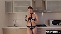 Skinny redhead covers herself in oil and masturbates in the kitchen
