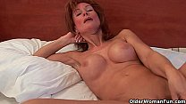Sultry grandma probes her old pussy with a dildo porn image
