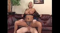 Big fake tits MILF Andrea in fishnets seduces y...