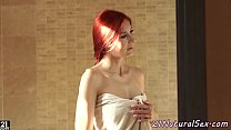 Redhead babe masturbates in the bathroom preview image