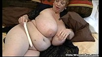 Fat granny Dagny with her big tits plays with v...