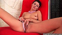 Elegant soccer mom is fingering her pussy and ass Image