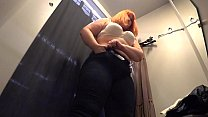 Screenshot A hidden cam era in a public fitting room at the...