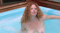 Curly redhead lady has fun in jacuzzi