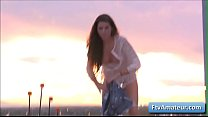 Sexy brunette amateur cutie Aveline finger her juicy bald pussy on top of the building