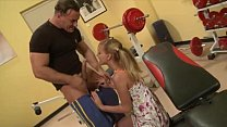 Malicious teen banged by muscly trainer in the gym