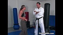 Karate girl is practice with trainer's Thumb