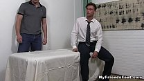 Handsome young businessman foot worshiped while relaxing