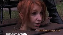 5558 A cute redhead slave gets covered with mud and piss outdoor preview