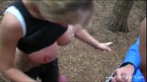 Blonde girl vs a group of guys outdoor in the forest Vorschaubild