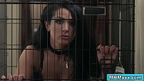 Caged busty Katrina Jade is awaiting her master to free her