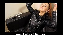 Rock chick in leather pants and leather biker jacket