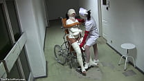 Patient in Wheelchair with Broken Legs and Straitjacket - TheWhiteWard.com