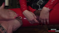 Femme dommes pegging submissive slave at their dungeon