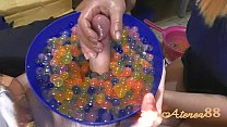 Young girl makes soft hanjob with lots of oil and water balls