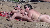 Blowjob on a nudist beach thumbnail
