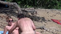 Blowjob on a nudist beach preview image