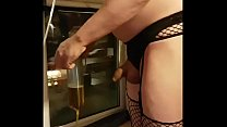 crossdressing bisexual sissy drinks his piss from a tube in the window showing the public blindfolded