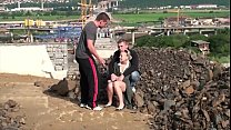Young blonde little hottie is fucked in public sex construction site threesome