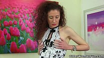 Skinny milf Scarlet from the UK gives her pussy a workout Image