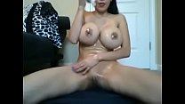 huge boob Asian girl oils up entire body and slams pussy down hard on dildo