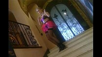 Image: Milf teases in a latex skirt stockings and boots
