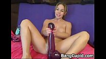 Brunette beauty inserts huge dildo Thumbnail